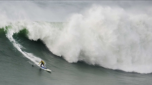 US surfer Garrett McNamara rides a wave during a surf session at Praia do Norte in Nazare