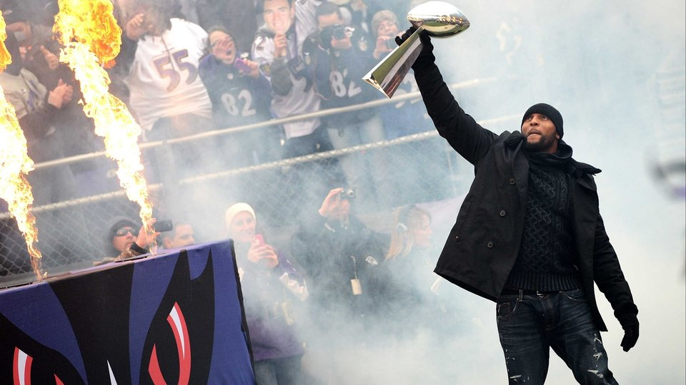 Baltimore Ravens linebacker Ray channels the spirit off the WWE as he celebrates with The Vince Lombardi Trophy