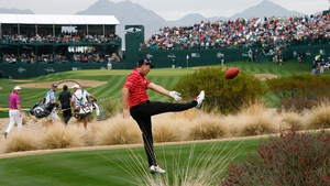 Pádraig Harrington kicks an American football into the grandstands on the 16th hole during the final round of the Waste Management Phoenix Open at TPC Scottsdale