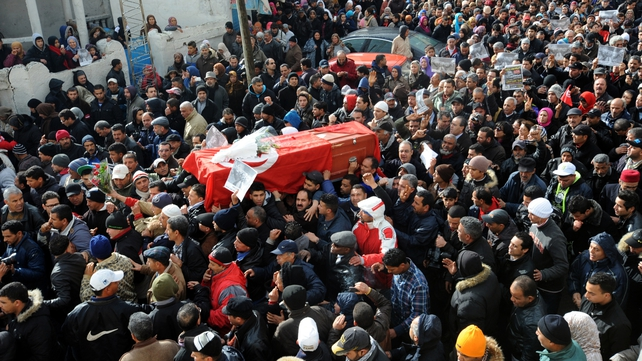 Chokri Belaid's coffin is carried through the streets of Jebel al-Jaloud