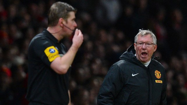 Alex Ferguson offers his opinion to a linesman