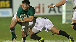 Ireland's Mark Roche is tackled by Henry Slade