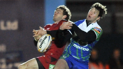 Scarlets' Kristian Phillips and Danie Poolman of Connacht contest a high ball