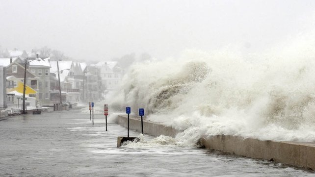 The ocean overflows the sea wall on Winthrop Shore Drive in Winthrop, Massachusetts