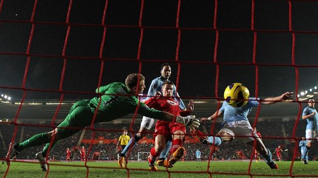 Joe Hart of Manchester City dives in vain as Steven Davis of Southampton scores their second goal