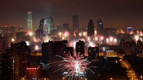 Fireworks illuminate the Beijing skyline to celebrate Chinese Lunar New Year of Snake