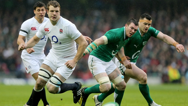 Joe Launchbury of England with Ireland's Peter O'Mahony and Cian Healy