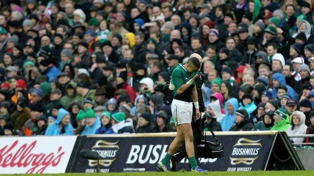 Simon Zebo goes off injured during the defeat to England
