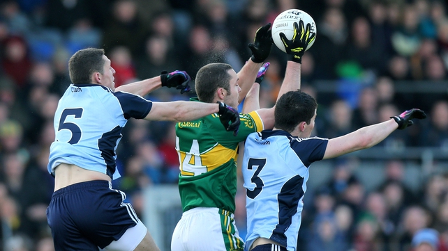 Kerry's Patrick Curtin jumps with Darren Daly and Rory O'Carroll of Dublin