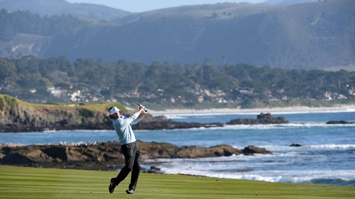 Brandt Snedeker hits his third shot on the 18th hole during the final round of the AT&T Pebble Beach National Pro-Am