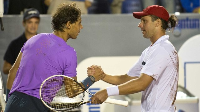 Rafael Nadal shakes hands with his vanquisher Horacio Zeballos
