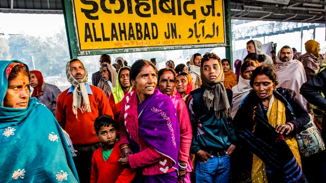 Hindu devotees wait for their train at Allahabad train station