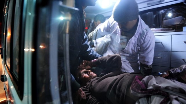 A man is loaded into an ambulance after being injured during the stampede