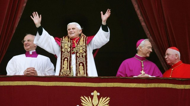 Pope Benedict XVI waves from a balcony of St Peter's Basilica in the Vatican after being elected by the conclave of cardinals in 2005