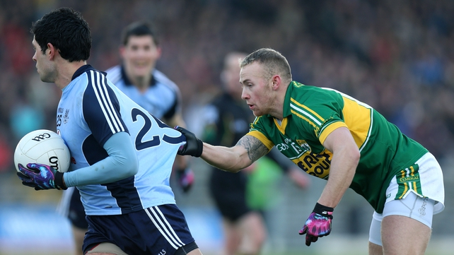 Kerry's Barry John Keane and Cian O'Sullivan of Dublin during yesterday's clash in Killarney