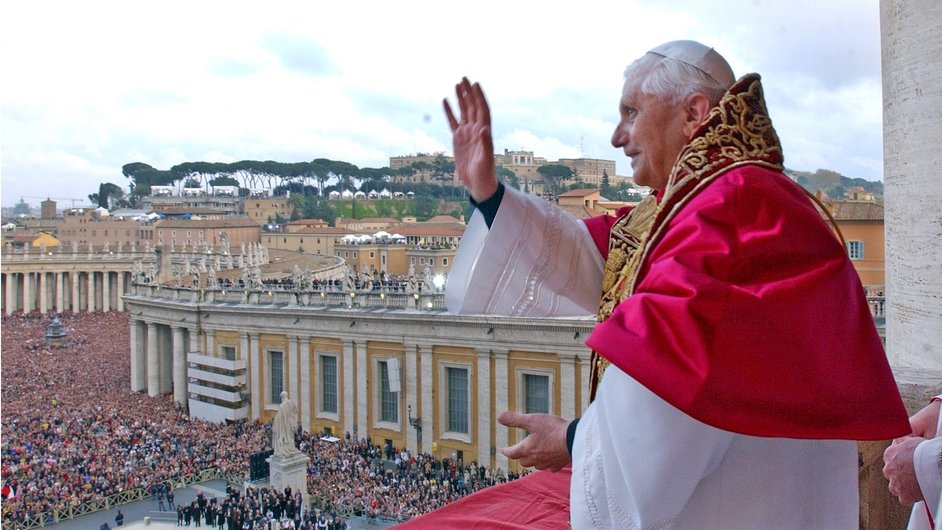 Pope Benedict XVI waves to the crowd in St Peter's Square after the announcement