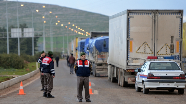 Turkish security personnel cordon off a street leading to the Cilvegozu border crossing with Syrian following the explosion