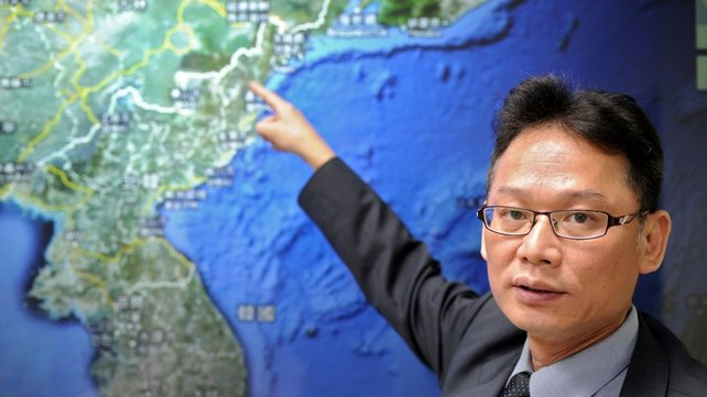 Chen Kuo-chang, a senior technical specialist from Taiwan's Seismology Center points towards a North Korean map at the location that North Korea staged a nuclear test