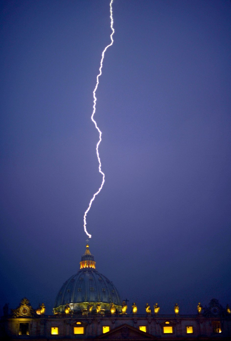 Lightning strikes St Peter's dome at the Vatican just hours after the Pope announced his retirement