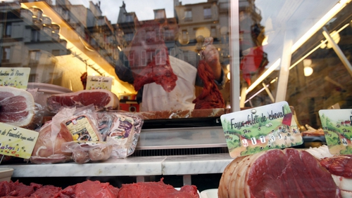 A butcher prepares meat at his horse meat butcher shop in Paris