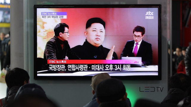 People watch a television broadcast reporting North Korea's nuclear test at a Seoul train station