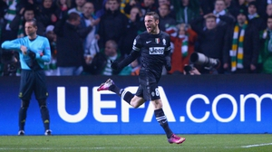 Claudio Marchisio of Juventus celebrates the opening goal of the night at Celtic Park
