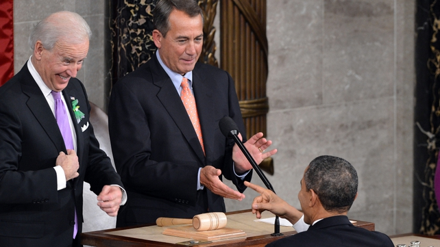 Mr Obama points to Vice President Joe Biden as House Speaker John Boehner looks on