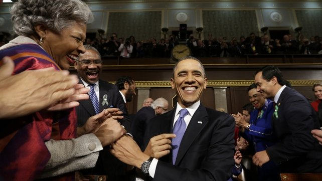 US President Barack Obama is greeted before his State of the Union address