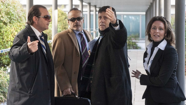 Doctor Eufemiano Fuentes (second from right) arrives at a court house in Madrid on 28 January 2013