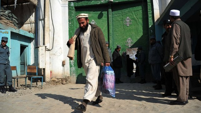 A freed Afghan prisoner leaves the main prison in Jalalabad yesterday as part of an amnesty introduced by President Hamid Karzai