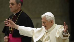 Pope Benedict XVI waves upon arrival for his weekly general audience at the Paul VI hall at the Vatican