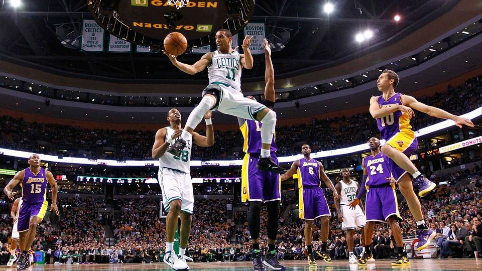 Courtney Lee of the Boston Celtics goes midair at TD Garden in Boston, Massachusetts