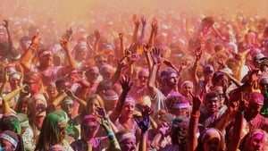 Runners party at Sydney Olympic Park after completing the Colour Run