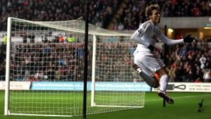 Swansea's Michu celebrates a goal against QPR