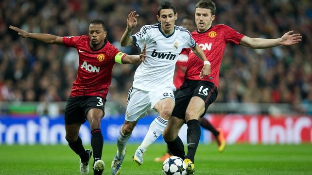 Angel Di Maria charging past United's Patrice Evra and Michael Carrick