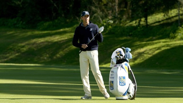 Matt Kuchar prepares to hit his second shot on the 12th hole