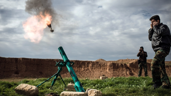Syrian rebels fire a mortar towards regime forces stationed at Kwiriss airport in Al-Bab