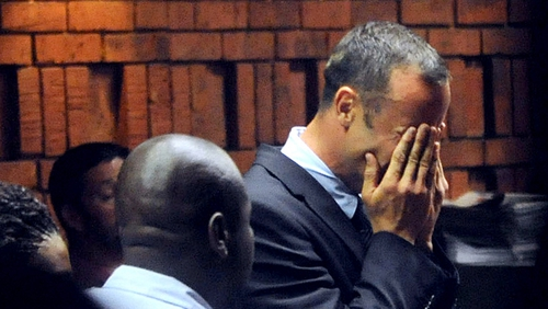 Oscar Pistorius wipes away tears during the court hearing