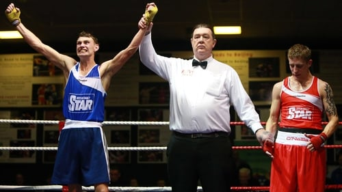 Sean McComb shows his delight as his hand is raised in victory after beating the much-fancied Eric Donovan
