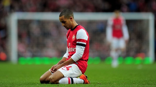 Theo Walcott was dejected as Arsenal exited the FA Cup