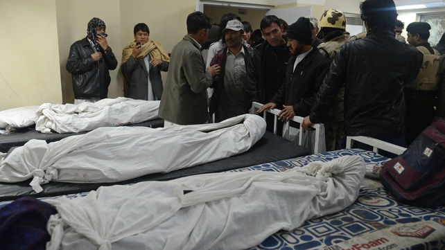 Relatives of victims of Quetta bombing gather at a hospital morgue to identify remains