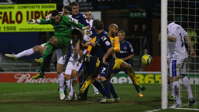 Matt Smith heads home Oldham's last gasp leveller