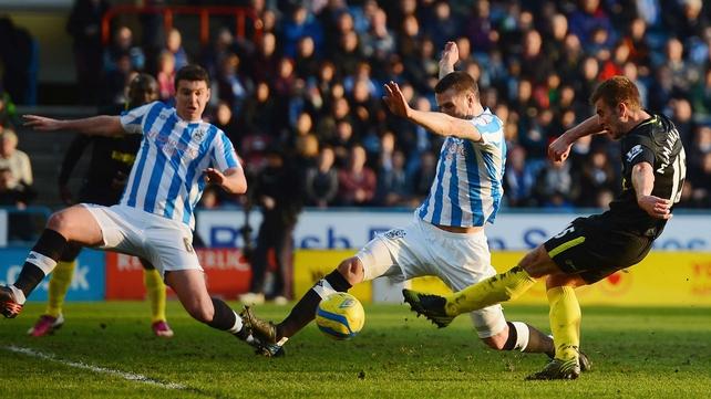 Callum McManaman opens the scoring for Wigan