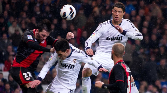 Cristiano Ronaldo goes for the ball with Sueliton Pereira of Rayo Vallecano
