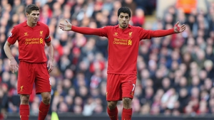 Steven Gerrard (left) is delighted speculation over Luis Suarez's future is over for now