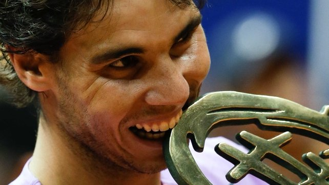 Rafael Nadal celebrates with the Brasil Open trophy