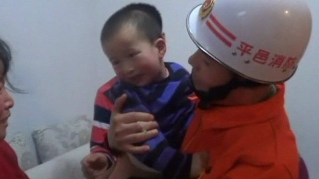 "After the girl was handed back into her mother's arms by fire-fighters, she said ""thank you"" to her rescuers"