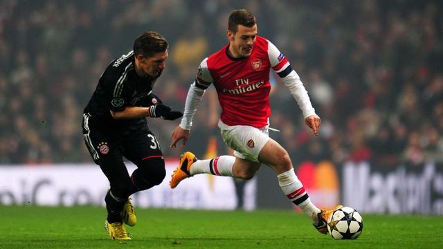 Arsenal's Jack Wilshere with Bayern's Bastian Schweinsteiger