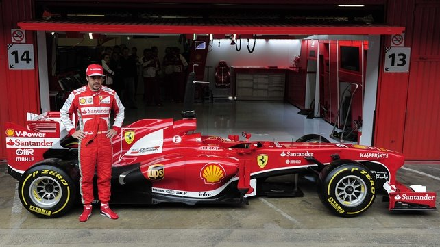 Fernando Alonso poses with the Ferrari F138 at the Catalunya race track