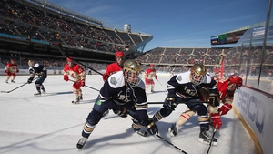 Members of ther Notre Dame Fighting Irish battle with the Miami Redhawks during the Hockey City Classic at Soldier Field in Chicago